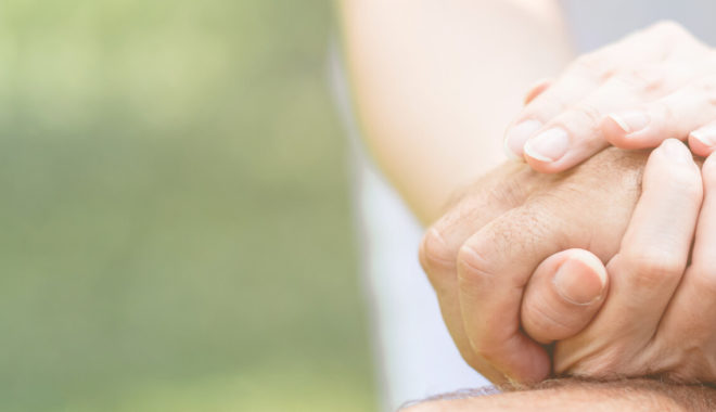 caregiver hand holding