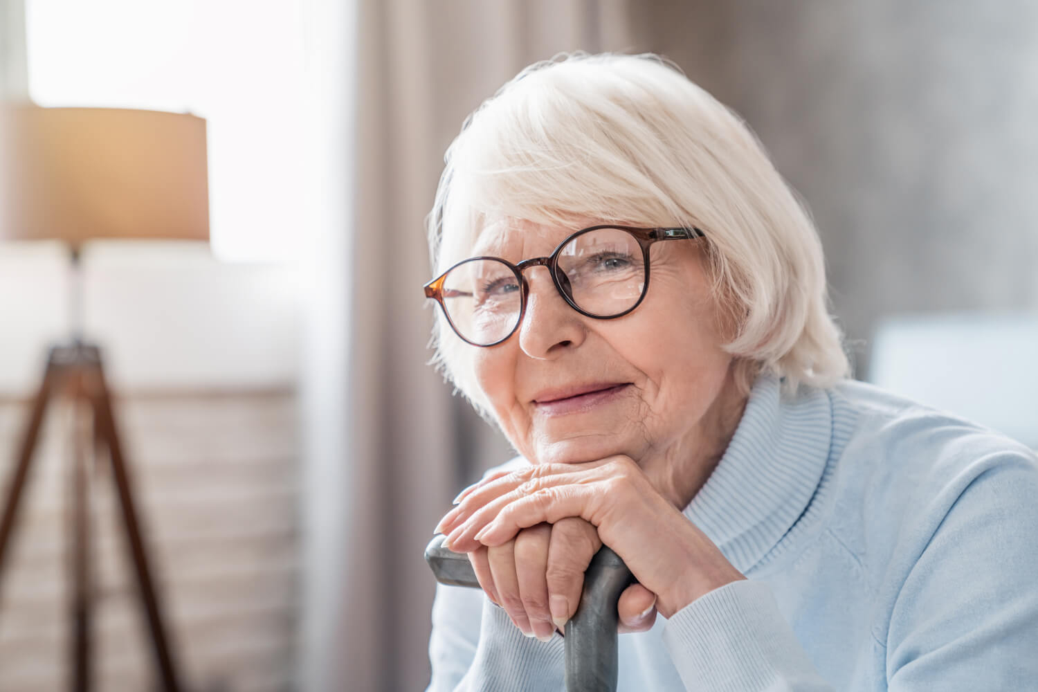 mature woman looking at care giver